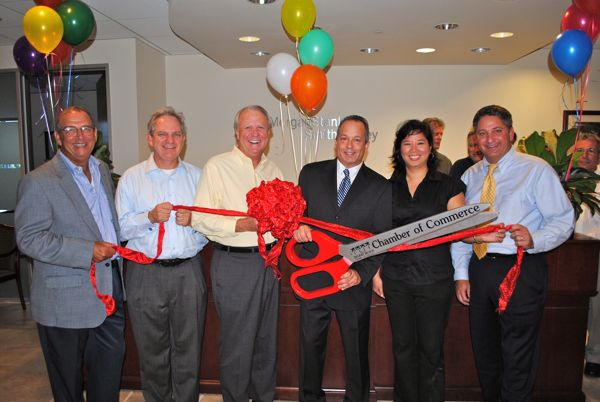 Gregg Weiss celebrated the opening of his Delray Beach office Monday with a little help from his friends.