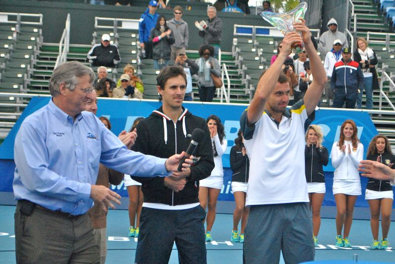 Delray Beach Mayor Tom Carney with Edouard Roger-Vasselin and Ernests Gulbis during the trophy presentation Sunday.